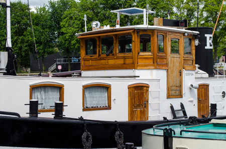 amstel river: Old vintage boat on the Amsterdam canal Stock Photo