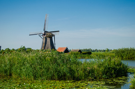 watermanagement: Traditional dutch windmill in famous Kinderdijk, The Netherlands