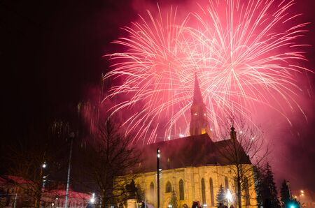 CLUJ - JAN 24: Fireworks for celebrating 157 years from the The United Principalities of Moldavia and Wallachia, also known as the Romanian United Principalities, on the Main Square of Cluj-Napoca, Jan 24, 2016, Romania