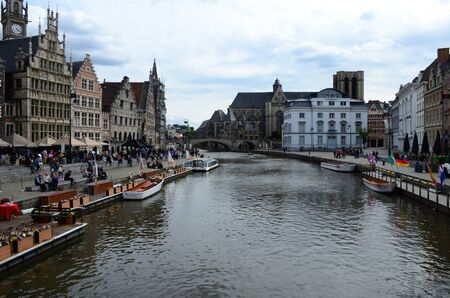 Gent, Belgium - May 16, 2016: Picturesque medieval buildings overlooking the Graslei harbor on Leie river in Ghent town, Belgium, Europe Editorial