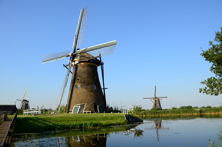 Traditional dutch windmills in the famous place of Kinderdijk,  Netherlands, Europe. Stock Photo