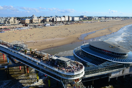 scheveningen: SCHEVENINGEN, THE HAGUE, NETHERLANDS - August 14, 2016: View of the beach and famous pier in a modern resort Scheveningen. Netherlands