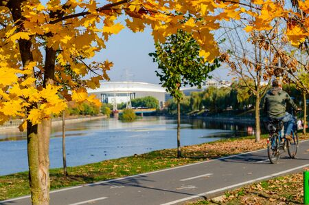 Cluj-Napoca, Romania: Bike path near the Somes River having the stadium in the background.