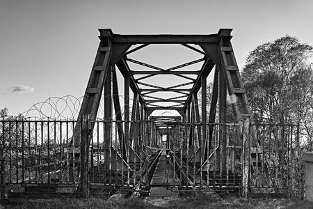 closed entrance to the railway tracks on the bridge