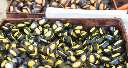 licorice: licorice candy and fruit on display at a street market Stock Photo