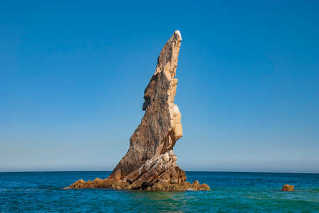 Neptunes Finger is rock formation that is easy to spot along the cliffs outside the marina in Cabo San Lucas, Mexico