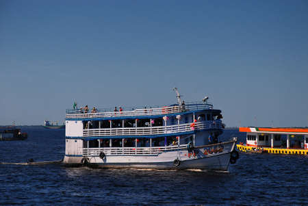 An Amazon River cruise boat taking tourists on day trips from the Port of Manaus in Brazil