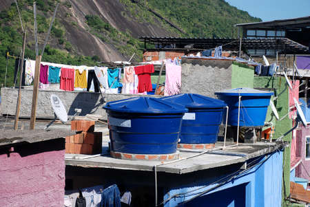 Water tanks on the roof of a house in a favela on the hillside of a steep hill on the outskirts of Rio de Janeiro, Brazil Publikacyjne