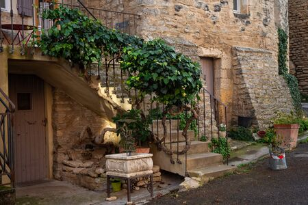 Street scene Goult ,provence , France. ivy growing up stair rail to terrace, medieval hill top village.stone buildings. Stock Photo