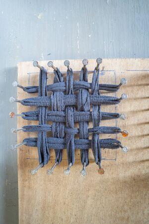 odd sock cut up on tawashi loom ,for making Tawashi.flat lay,room for text.