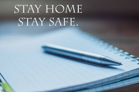 Stay Home Stay safe,concept ,pen on notebook,background  ,Wallpaper.