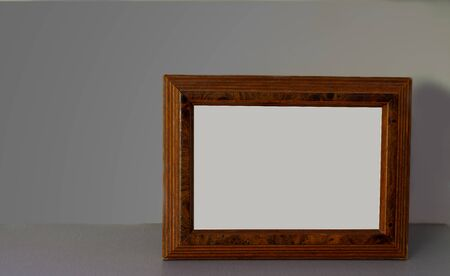 Mock up of wooden picture frame on modern counter.