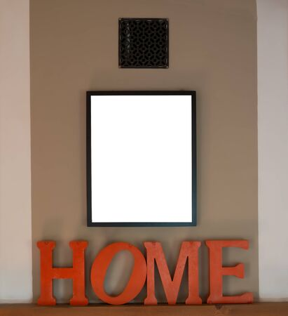 Mock up  black picture frames on  cream wall with home as a decoration. ,concept stay home ,template.