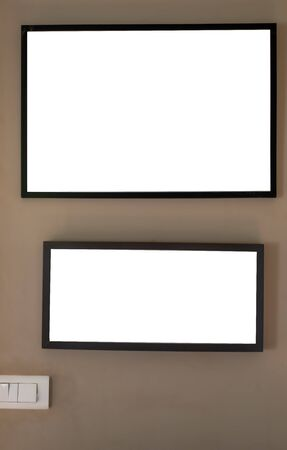 Mock up  black picture frames on  cream wall with light switch template. Banque d'images