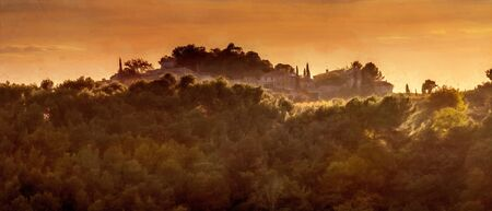 digital painting of hilltop village at sunset with beautiful light. Vaucluse, south of France.