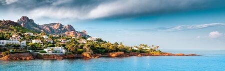 the masssif de L'esterel ,seen from the beach. panarama,showing the mediterranean,& coastal houses., Var ,provence, France.
