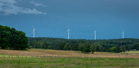 wind turbines in agriculture setting, alternative energy. Lozere, France.