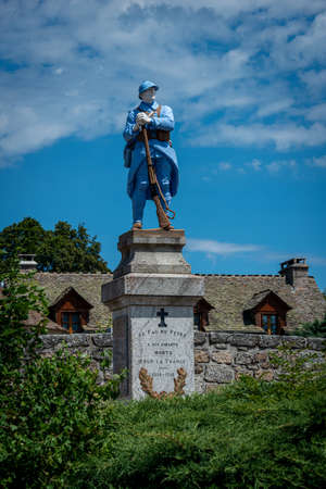 war memorial for the men lost in the first world war, statue of a blue soldier. lozere, France.
