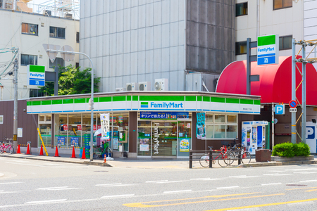 Osaka, JAPAN - CIRCA June, 2018: FamilyMart (one word) convenience store is the third largest in 24 hour convenient shop market, after Seven Eleven and Lawson. Foto de archivo - 108139823