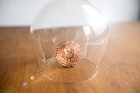 Bitcoin covered by a glass Stock Photo