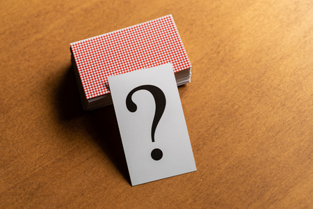 Question mark heap on table concept for confusion, question or solution
