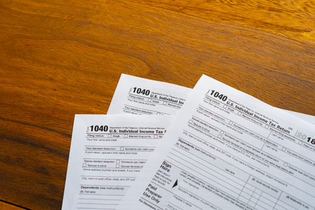 1040 Tax Return Form on the Dark Red Background