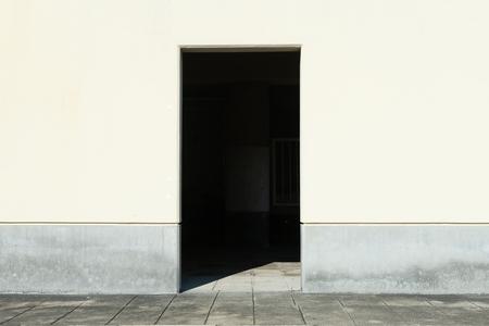 sidewalk by street wall and door