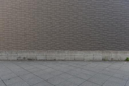 Fondo de pared de calle, fondo industrial, calle urbana de grunge vacío con pared de ladrillo de almacén