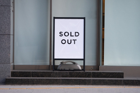 Sold out billboards placed in front of store boutiques