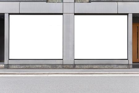 Fronte negozio con grande cartellone pubblicitario Archivio Fotografico