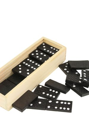 a box of domino tiles and scattered tiles isolated photo
