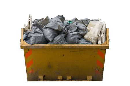 skip: a skip full of refusetrash sacks isolated on a white background Stock Photo