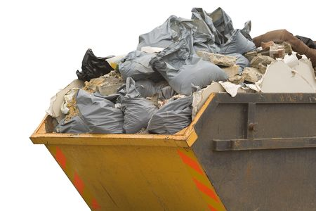 junked: a skip full of refusetrash sacks isolated on a white background Stock Photo