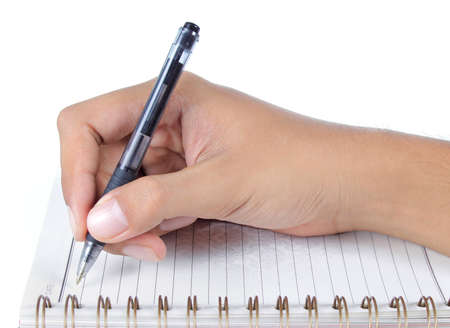 chronicle: mans hand writing on a book Stock Photo