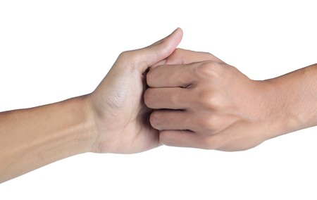 Thumb wrestling, a symbol of competition photo