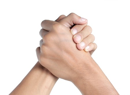 gesture of mans hand shake or arm wrestling photo