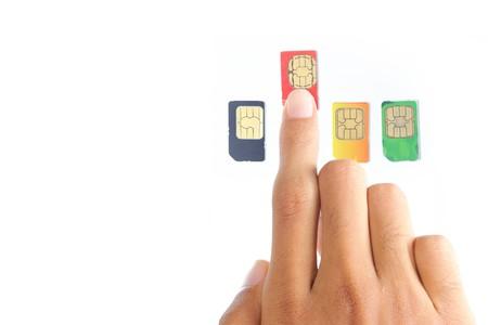 hand was choosing the best sim card or celular provider Stock Photo
