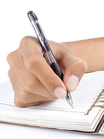 Geste des Mannes Hand auf ein Buch schreiben Standard-Bild