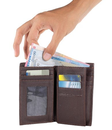 gesture of hand taking money from wallet photo