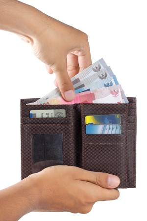 Gesten der Hand nehmen Geld aus der Brieftasche Standard-Bild