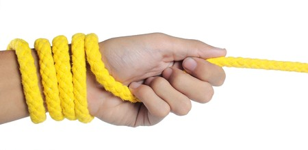struggling: hand was pulling yellow rope