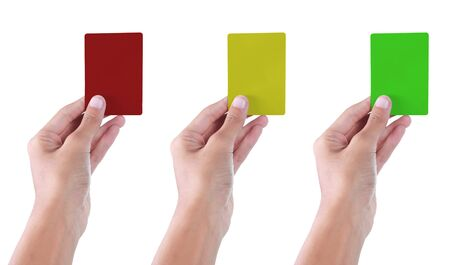 gesture of hand giving red, yellow and green card Stock Photo - 7899469