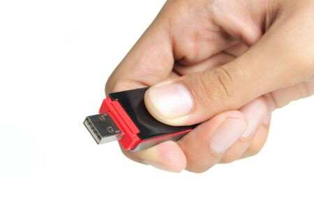 gesture of hand holding a flash disk photo
