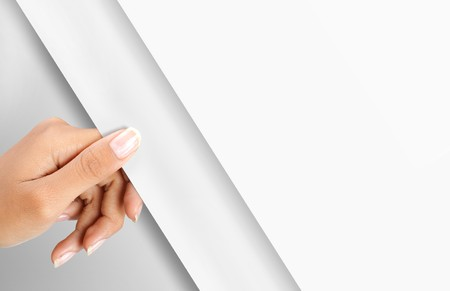 gesture of hand turning white paper page Stock Photo - 8143705