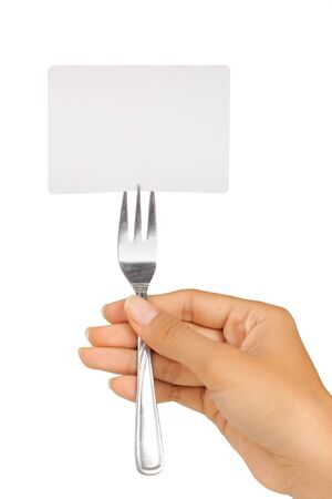 gesture of womans hand holding a fork with card Stock Photo - 8143707