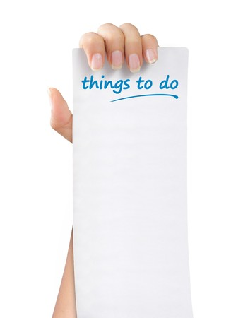 things to do: hand was holding of a things to do paper note