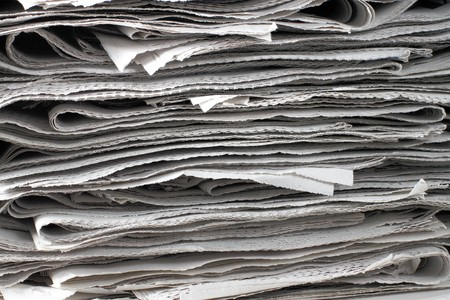texture shot of a pile of newspaper photo