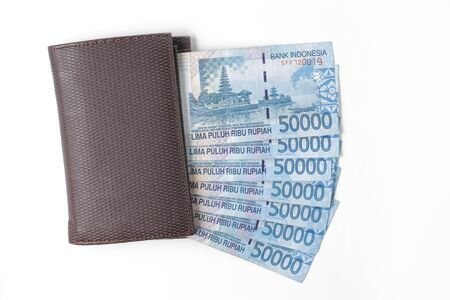 still life photo of wallet and money over white background photo