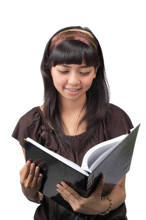 college girl reading a book over white background Stock Photo - 8699550