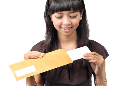 woman open a letter over white background Stock Photo - 8713940
